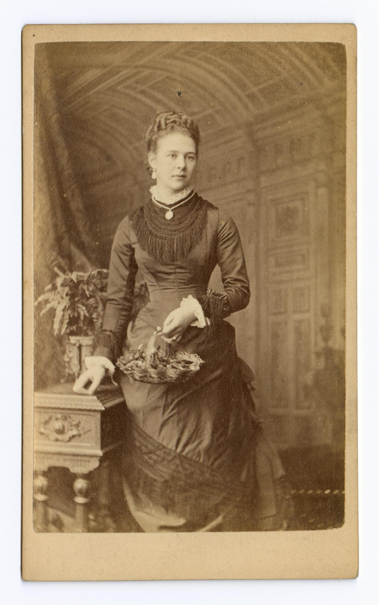 Unidentified Lady Holding A Basket