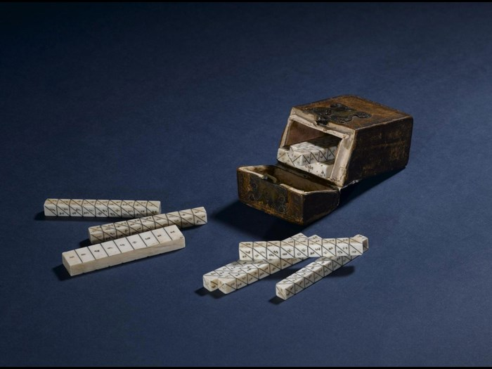 Set of Napier's bones in ivory, in a small leather case, c. 1650. On display in Level 1 of the Scottish galleries in the National Museum of Scotland.