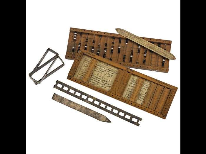 Arithmetical compendium, combining strip form Napier's Bones and bead-type abacus, in boxwood case, by Robert Jole of London, c. 1670.