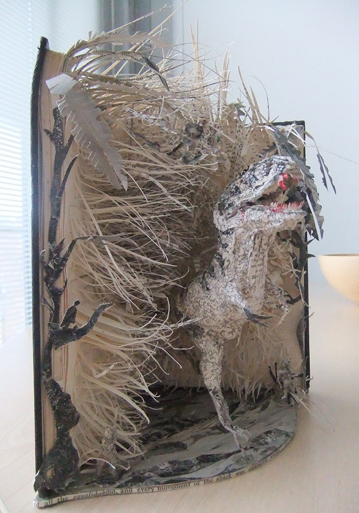 Dinosaur book sculpture