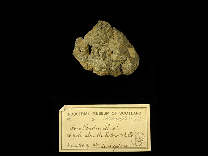 Specimen of hornblendic schist with 19th century museum label: 'Hornblendic schist. 20 miles above the Victoria Falls. Presented by Dr Livingstone.'
