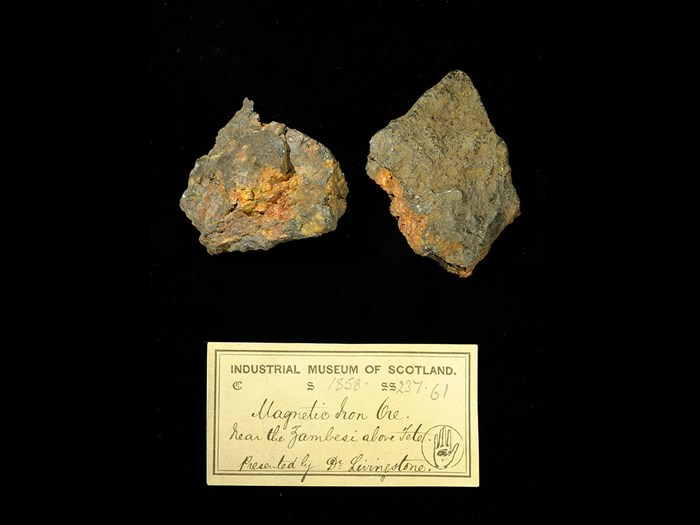 Specimens of iron ore with 19th century museum label: 'Magnetic iron ore. Near the Zambesi above Tete. Presented by Dr Livingstone.'