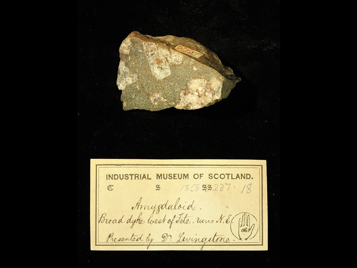 Specimen of amygdale with 19th century museum label: 'Amygdaloid. Broad dyke west of Tete, runs NE. Presented by Dr Livingstone.'