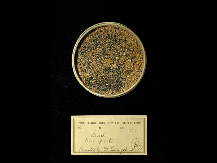 Specimen of sand with 19th century museum label: 'Sand. West of Tete. Presented by Dr Livingstone.'
