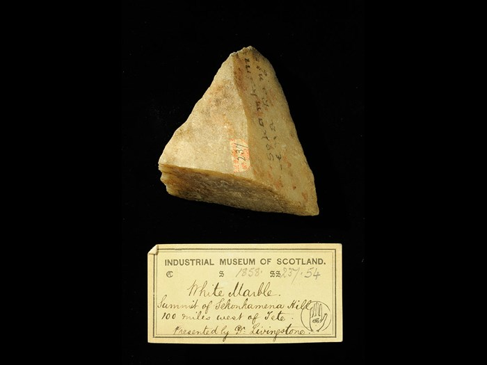 Specimen of white marble with 19th century museum label: 'White marble. Summit of Sekankamena hill 100 miles west of Tete. Presented by Dr Livingstone.'