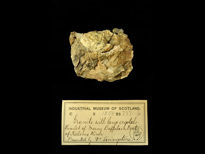 Specimen of granite with crystals with 19th century museum label: 'Granite with large crystals. Rivulet of many buffaloes, west of Kalomo river. Presented by Dr Livingstone.'