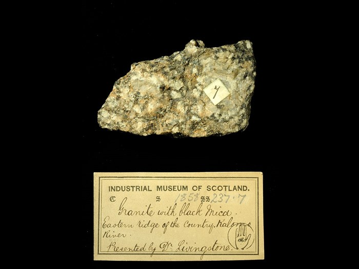 Specimen of granite with black mica with 19th century museum label: 'Granite with black mica. Eastern ridge of the country, Kalomo river. Presented by Dr Livingstone.'