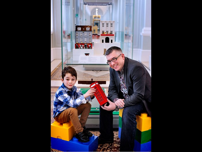 Lucas Hashem-Ford (7) helps artist in LEGOⓇ bricks Warren Elsmore set up a special display of models at the museum.