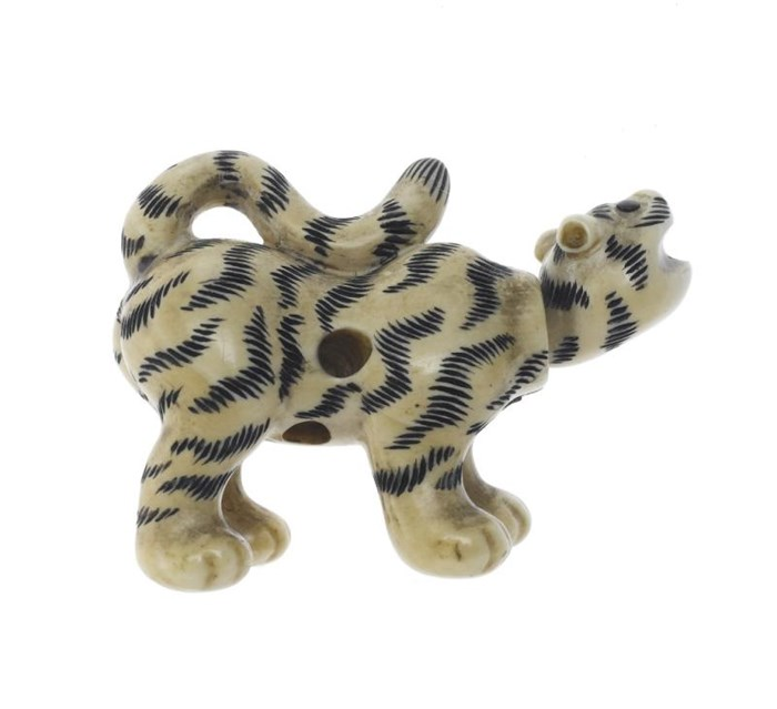 Carved ivory netsuke of a tiger