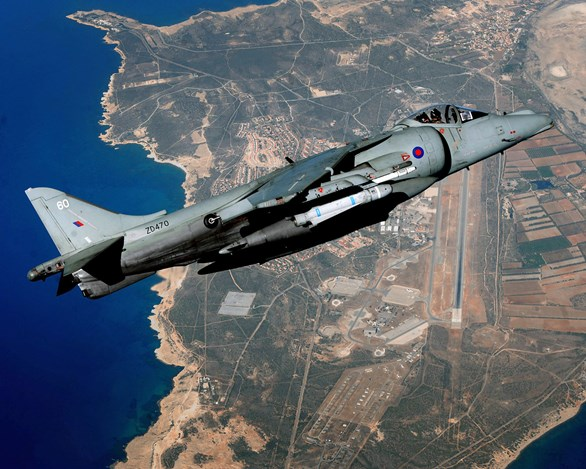 A Joint Force Harrier jet is pictured high over RAF Akrotiri in Cyprus shortly before the iconic aircraft was decommissioned. © Crown Copyright.