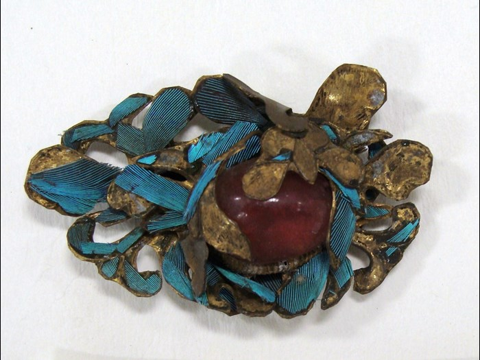 A jewel on the headdress before conservation