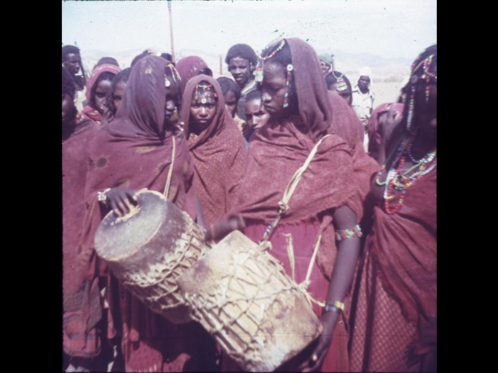 Slide of girls wearing red clothes, playing drums: Eritrea, 1960s, photographed by Jean Jenkins.