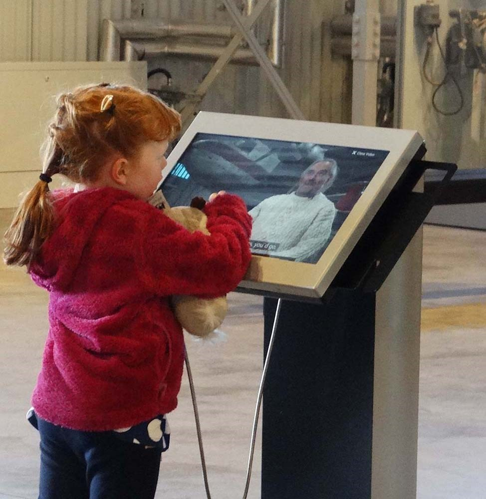 Viewing the interactive display screens in the Civil Aviation hangar.