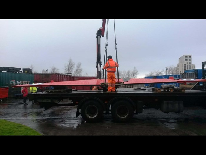 Hoisting the Hawk wings off a heavy loader lorry at National Museums Collection Centre.