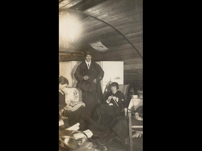 Nurses relaxing in their accommodation at a British hospital at Wimereux, France, 1918. This photograph was taken by Janet Cadell, a Voluntary Aid Detachment nurse serving with the Red Cross.