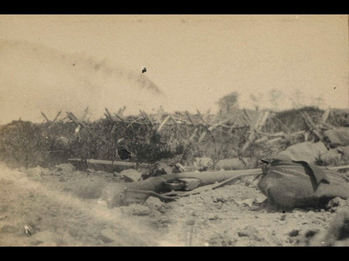 View taken from a dangerous position outside a front-line trench by Lieutenant LA Lynden-Bell, 1st Battalion Seaforth Highlanders, 1915. He took the photograph lying down. His rifle can be seen in the foreground.