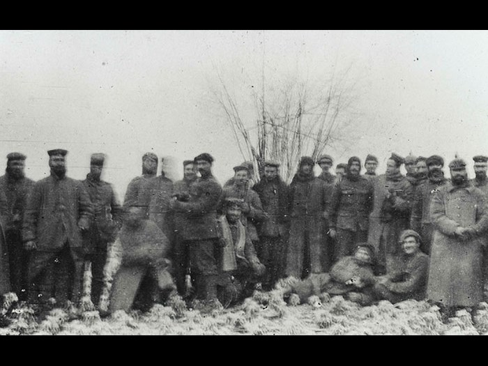 British and German soldiers pose together for the camera of Lieutenant AHC Swinton, 2nd Battalion Scots Guards, during the unofficial truce which occurred on parts of the front line on Christmas Day, 1914.