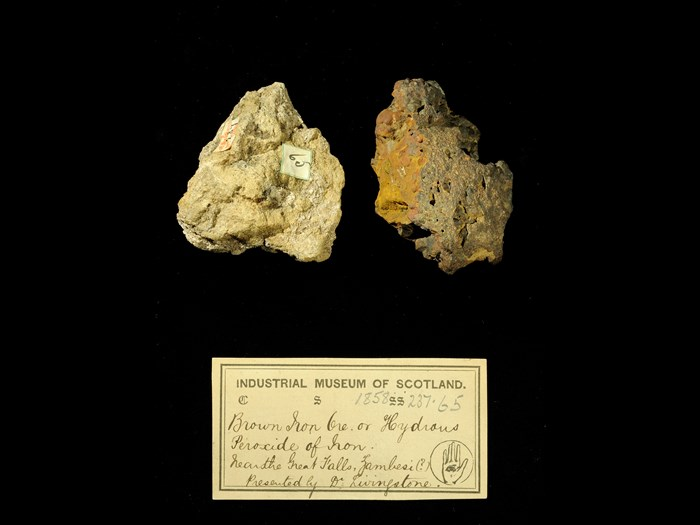 Specimens of iron ore with 19th century museum label: 'Brown iron ore or hydrous peroxide of iron. Near the Great Falls, Zambesi (?) Presented by Dr Livingstone.'