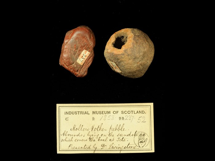 Specimen of a hollowed rock with 19th century museum label: 'Hollow & other pebble. Abounds lying on the sandstone which covers the coal at Tete. Presented by Dr Livingstone.'