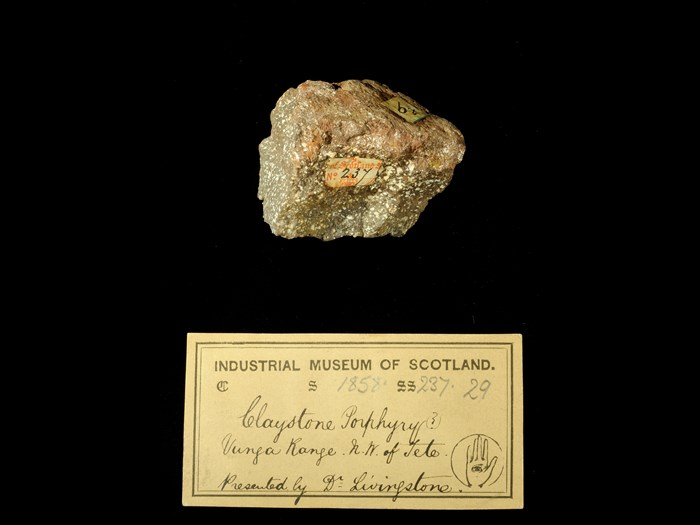 Specimen of clay-stone porphyry with 19th century museum label: 'Claystone porphyry (?) Vunga Range. NW of Tete. Presented by Dr Livingstone.'