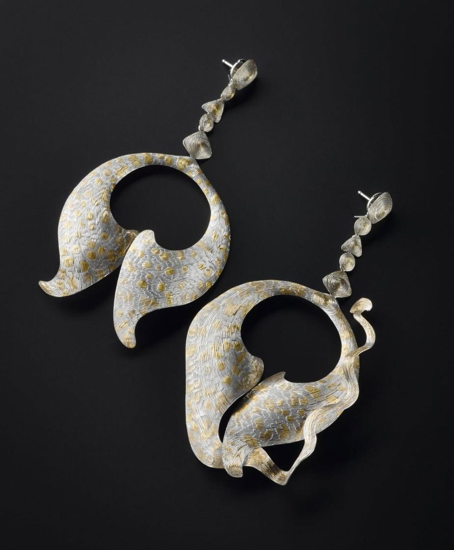 Platinum earrings made by Andrew Metcalfe and designed and decorated by Malcolm Appleby, 1993. You can see these earrings in the Making and Creating gallery in the National Museum of Scotland.