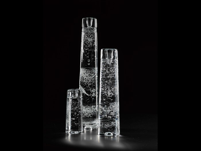 'Arkipelago' candle holder of cast clear glass with visible bubbles and irregular surface, designed by Timo Sarpaneva for Iittala, Finland