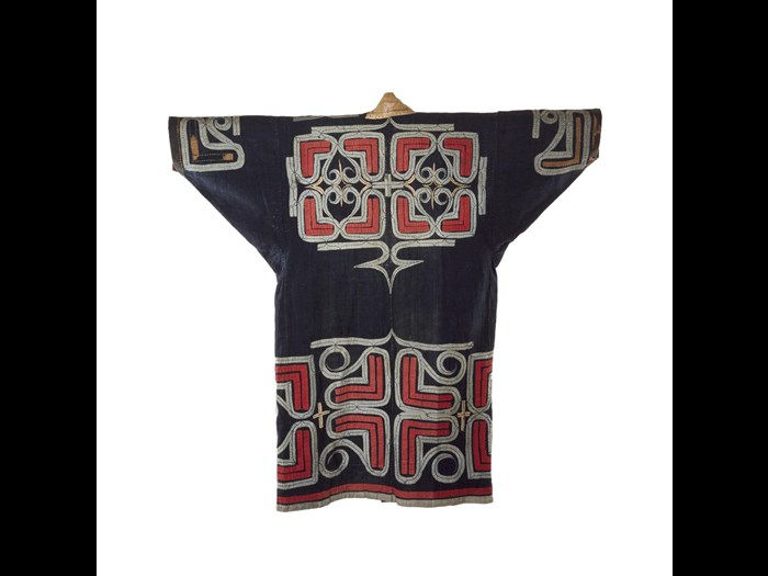 Robe (ruunpe), dark blue cotton cloth with red and white abstract applique decoration, worn during a ceremony: Japan, Hokkaido, Ainu, 19th to early 20th century. On display in the Living Lands gallery, National Museum of Scotland.