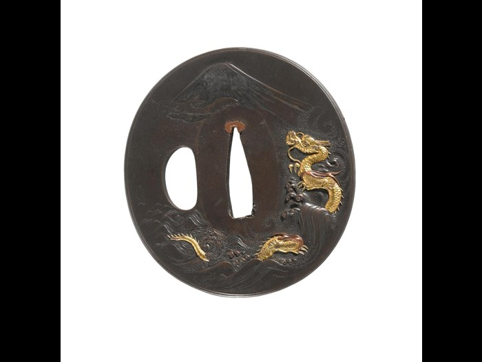 Tsuba or sword guard with a dragon and Mt Fuji, Miho-no-Matsubara on reverse. Hamano style: Japan, made by Hakuryo, 19th century. On display in the Artistic Legacies gallery, National Museum of Scotland.