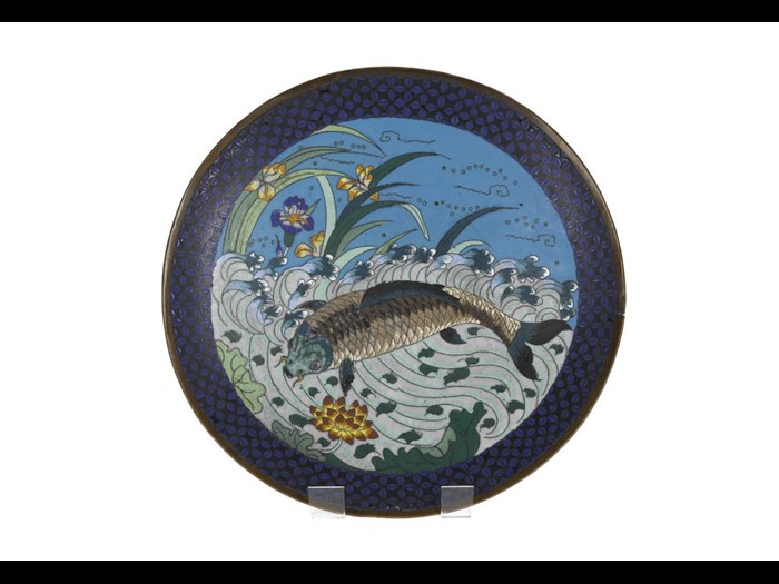 Dish of cloisonne enamel depicting a carp amongst waves with lotus and iris flowers. Japan, 19th century. On display in the Inspired by Nature gallery, National Museum of Scotland.