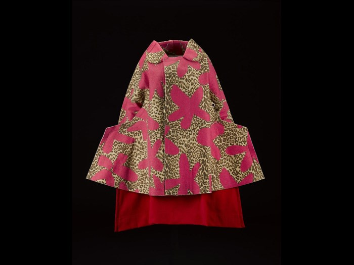 Woman's coat or jacket, felted wool in bright pink floret and leopard print, with angular shaped hips, from the Commes des Garcons, 'Flat' or '2D' collection, Autumn-Winter 2012, designed by Rei Kawakubo. On display in the Fashion and Style gallery.