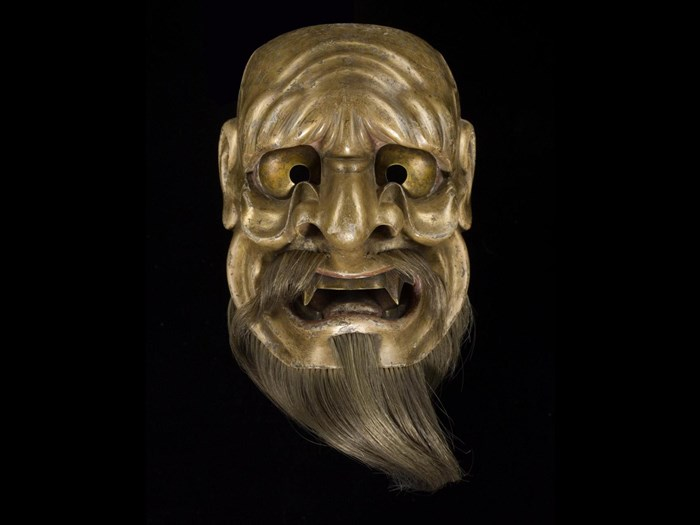 Mask representing the evil spirit Kaname-ishi, for No drama, signed: Japan, by Deme Tōhaku Mitsutaka, 1675-1715. On display in the Performance and Lives gallery, National Museum of Scotland.