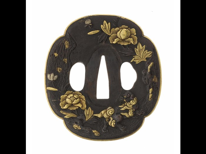 Tsuba or sword-guard of iron decorated with shakudo nanako with peonies, lion-dogs, rocks and gilt edge: Japan, possibly 18th century.