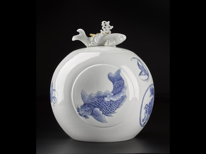 Spherical water jar of porcelain with underglaze blue decoration of carp, lion-dogs and children: Japan, Hirado Mikawachi, 1780 - 1880