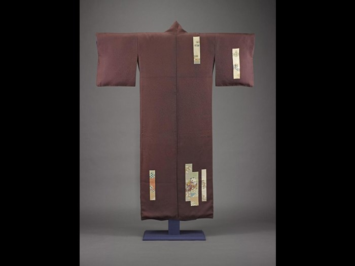 Woman's mauve silk kimono with figured satin crepe stencil painted with scattered poem cards in different colours, with a white silk lining: Japan, c1930-40.