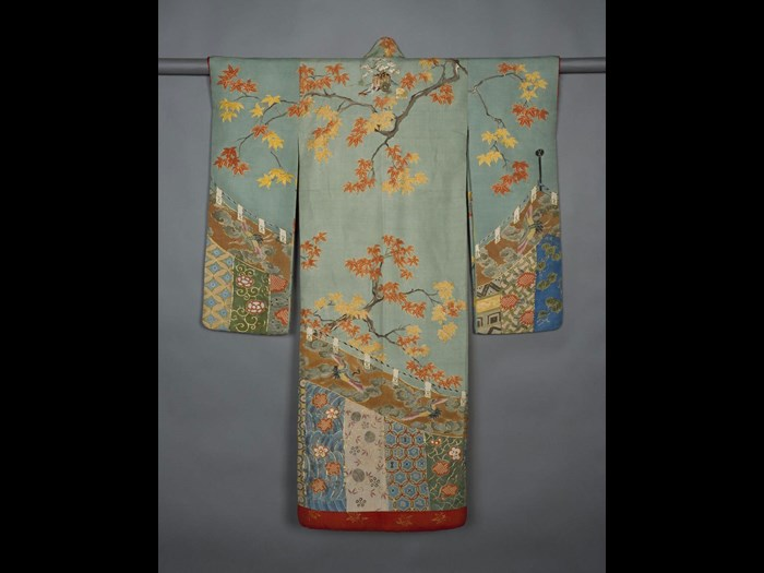 Young woman's robe (furisode), of rep silk with design of maple branches above a festival curtain, outlined with couched gold thread, with padded hem and red silk lining, possibly for wedding ceremony: Japan, 1868-1900.