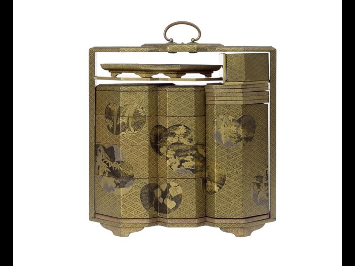Picnic cabinet (sageju) of gold lacquered wood, containing tiered box (jubako) of four sections, sake bottle, five stacking trays and one single tray, decorated with panels containing floral and landscape designs: Japan, 18th century.