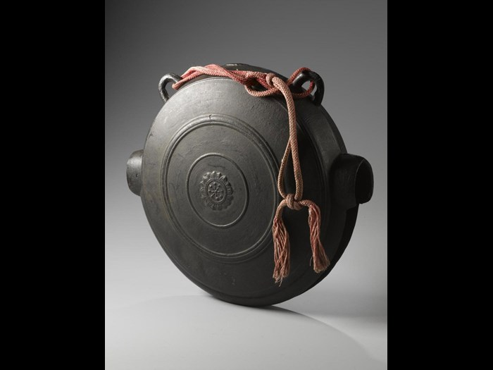 Buddhist crocodile-mouth gong (waniguchi) of bronze with loops for suspension: Japan.