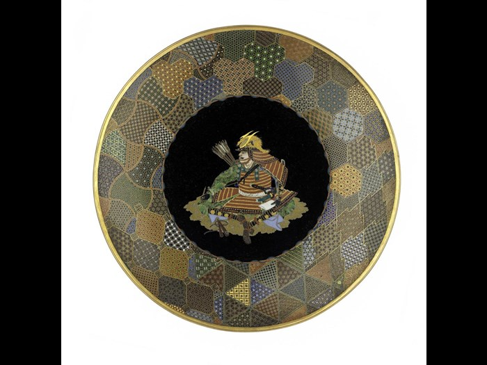 Dish of copper and cloisonne enamel with a seated figure of a warrior in centre: Japan, Yokohama, by Goto Seizaburo, c1880.