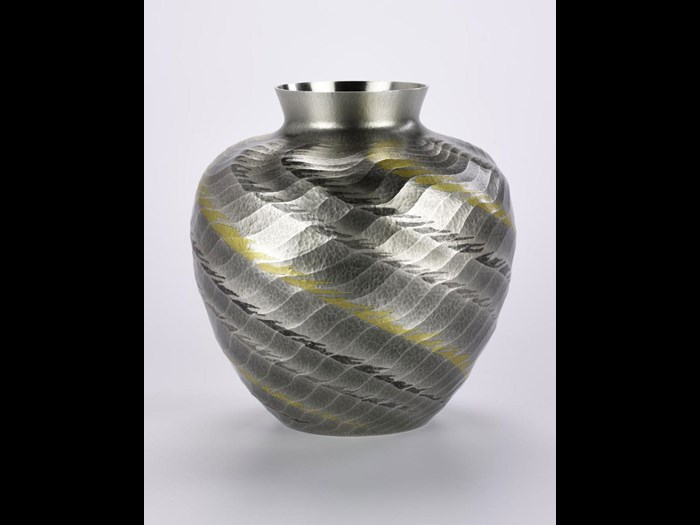Vase entitled Kuroshio, of hammered silver with nunome-zogan (textile-imprint inlay) of gold and lead: Japan, by Ōsumi Yukie, 2000.