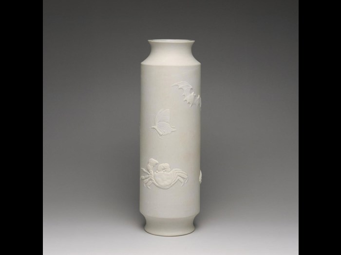 Bisque-fired cylindrical porcelain vase with decoration of insects and sea creatures in low relief: Japan, Hirado Mikawachi, by Yamoto, 1840-80.
