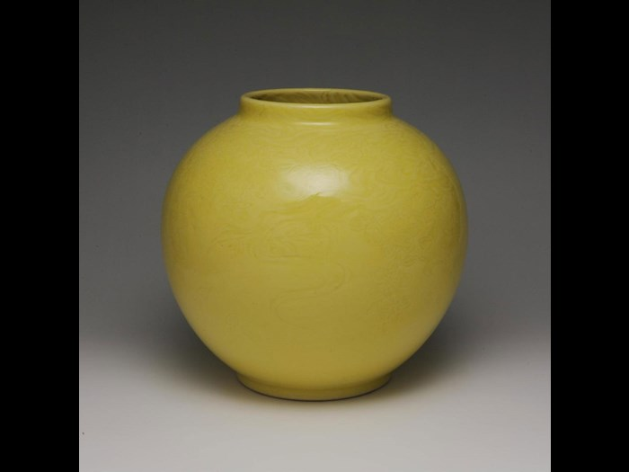 Globular jar of porcelain with incised plants, with wooden storage box: Japan, by Seifu Yohei V, 1950  75.