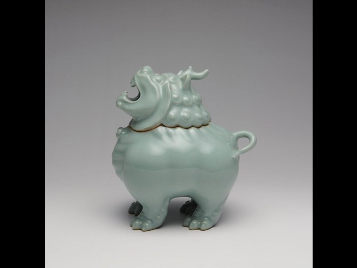 Incense burner of stoneware with celadon glaze in the form of a lion-dog, in two parts: Japan, by Suwa Sozan II, 1922-77.