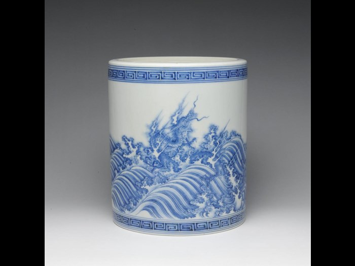 Straight-sided porcelain water jar (mizusashi) with design of blue dragons in surging waves: Japan, Hirado Mikawachi, c1700.
