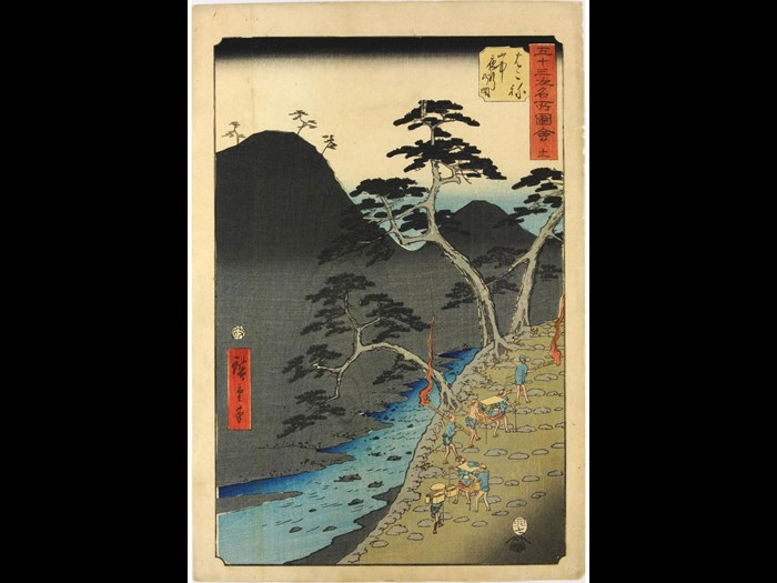 Colour woodblock print number 11 entitled Hakone: yamanaka yako no zue (Hakone: Night Travel in the Mountains) from the series Gojūsan tsugi meisho zue (Famous Places Along the 53 Stations [of the Tōkaidō] Illustrated) depicting an evening scene of travellers, some being carried in palanquins and others bearing torches, as they pass through the mountains: Japan, by Utagawa Hiroshige, 1855.