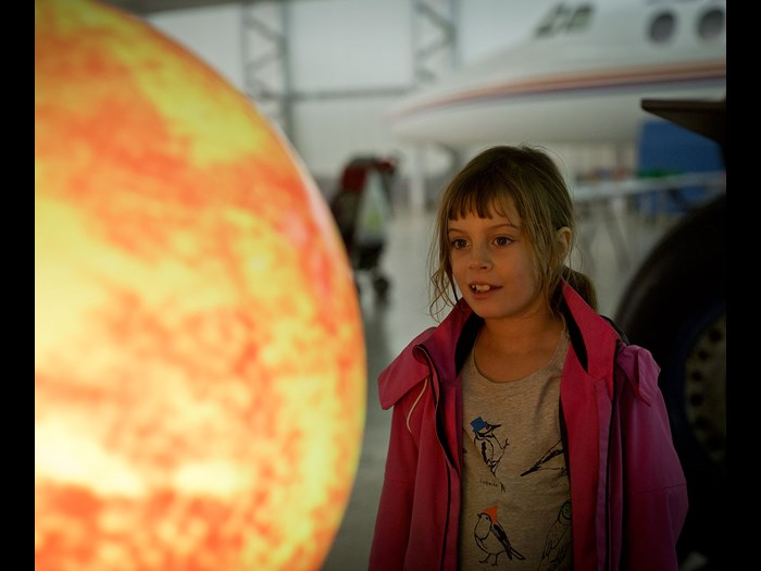 Looking at globes of the planets  © Ruth Armstrong Photography.