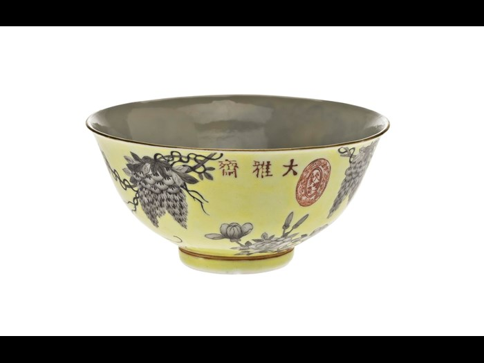 Bowl of porcelain, decorated in overglaze enamels with a yellow ground and grisaille design of wisteria, peony and a bird, with inscription and marks, part of a porcelain group made in celebration of the 60th birthday of the Empress Dowager Cixi: China, Jiangxi Province, Jingdezhen kilns, Qing Dynasty, Guangxu reign, 1894 AD.