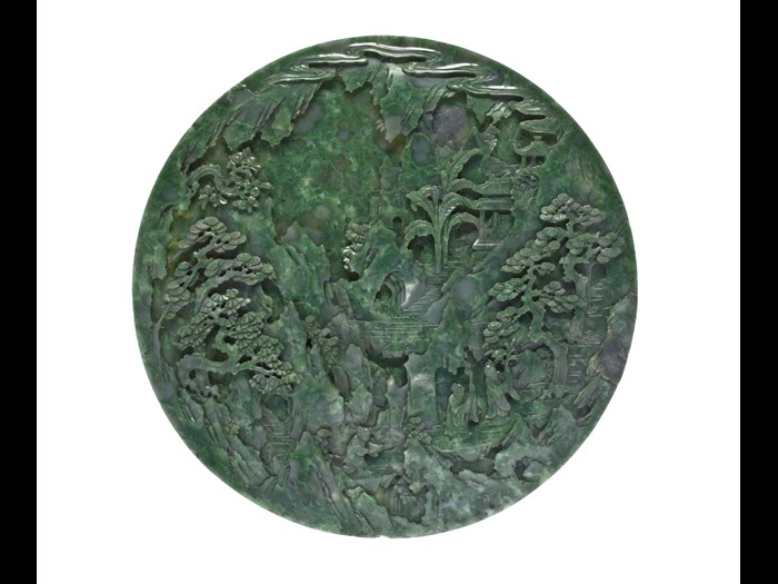 Circular table screen (yuan pingfeng) of dark green jade, carved on one side with two Daoist immortals and an attendant carrying offerings, and on the other a landscape: China, Qing Dynasty, 18th century AD.