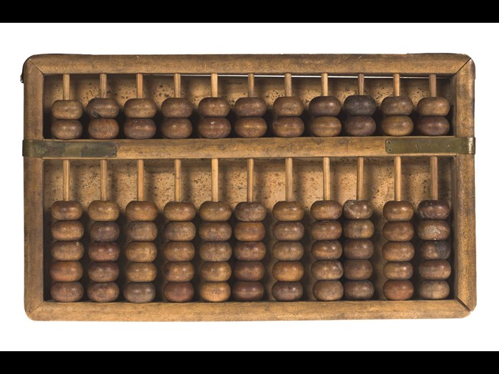 Suanpan (abacus) of wood and brass, used for both decimal and hexadecimal calculations: China, Qing Dynasty, early 20th century.