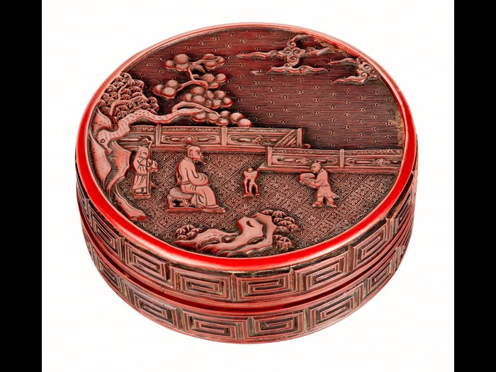 Box of red lacquered wood, small circular, decorated with a sage seated in a garden flanked by two attendants, with thunder pattern on side: China, Yuan dynasty, by Zhang Cheng, 1279-1368.