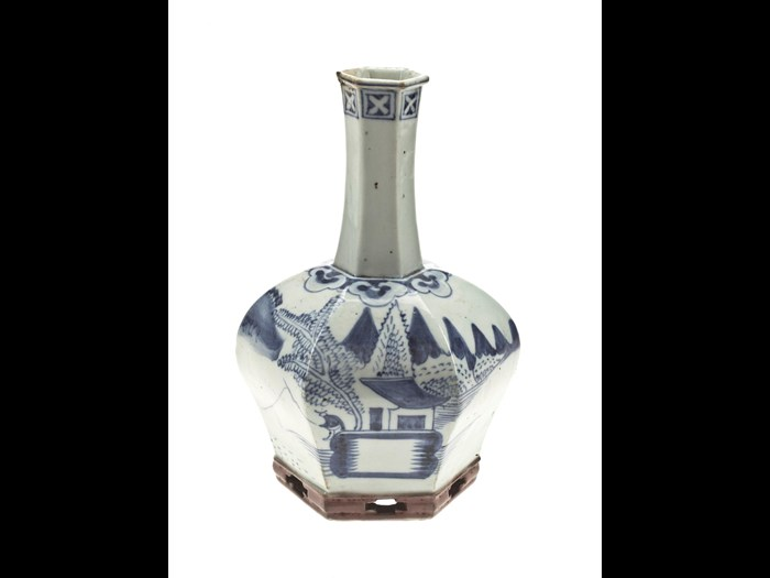 Vase of glazed resonant porcelain, bulbous and hexagonal with a perforated foot, with underglaze blue decoration of a fisherman in a landscape: Korea, 16th-17th century.